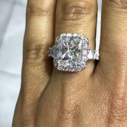 Three Stone Halo Radiant Cut Engagement Ring